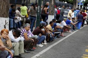Venezuelans line up to buy staple items outside state-run Bicentenario supermarket in Caracas. Source: Reuters.